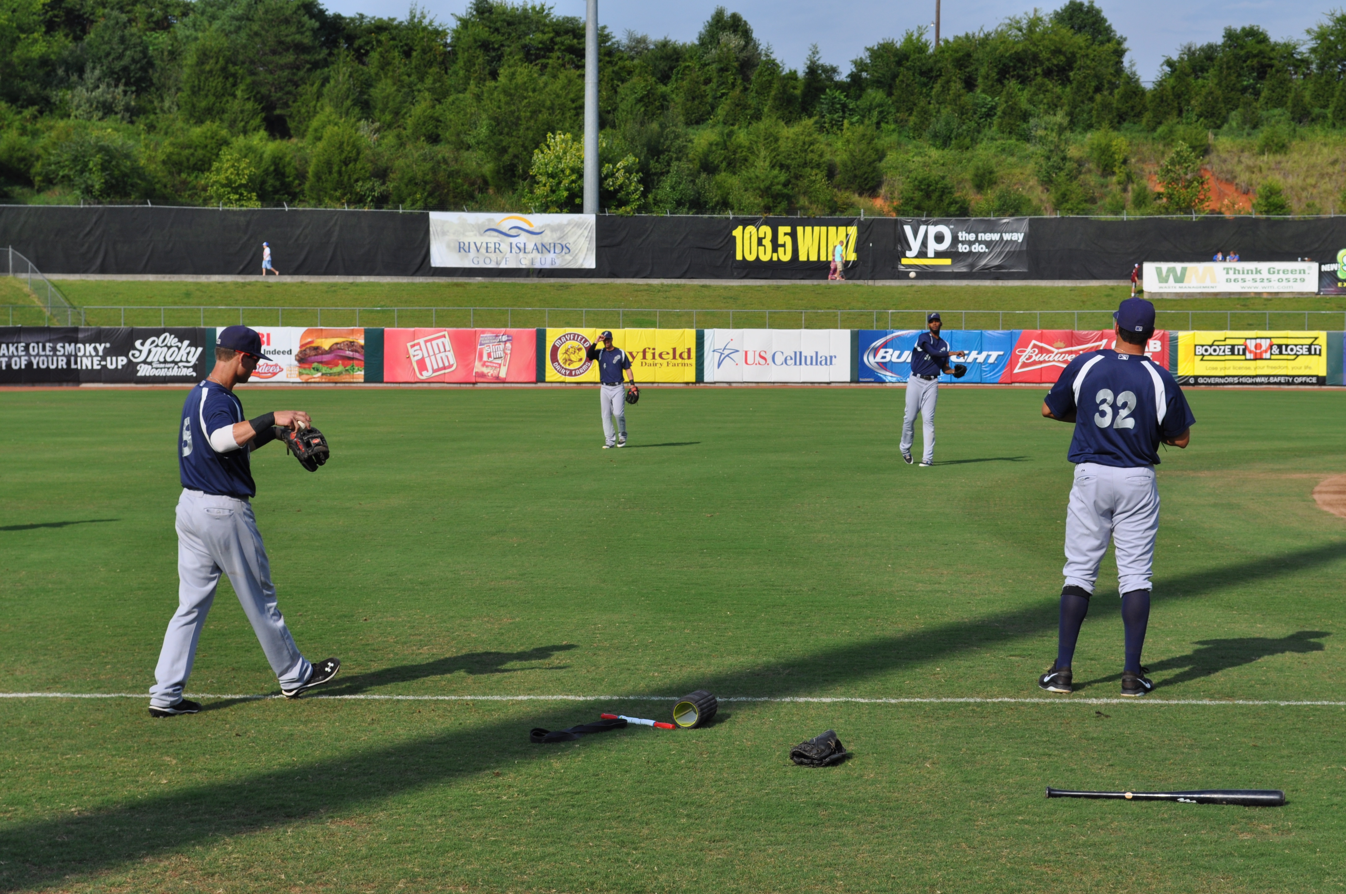 2B Devin Lohman (#8) with SS Brodie Greene (#4) and 3B Seth Mejias-Brean (#32) with RF Juan Duran (#31)  loosening up before Saturday evening's game.