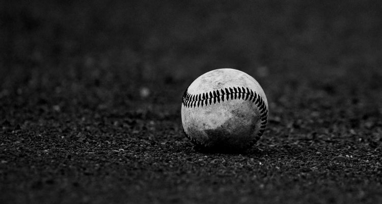 Generic Baseball In Dirt Photo